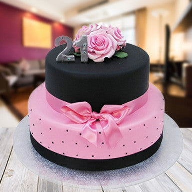 It's a two-tier cake overloaded with chocolates and decorated by using pink roses.