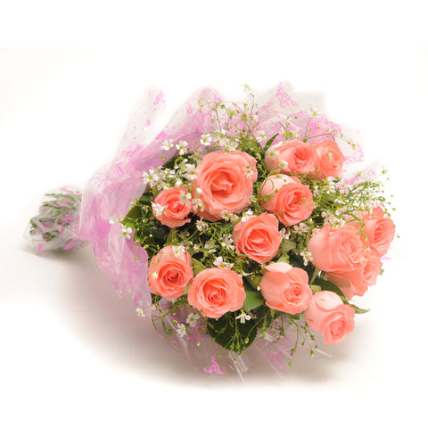 A beautiful bouquet of fresh pink roses cover by pink paper.
