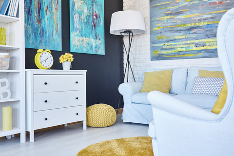 Living room with yellow and blue accent decor