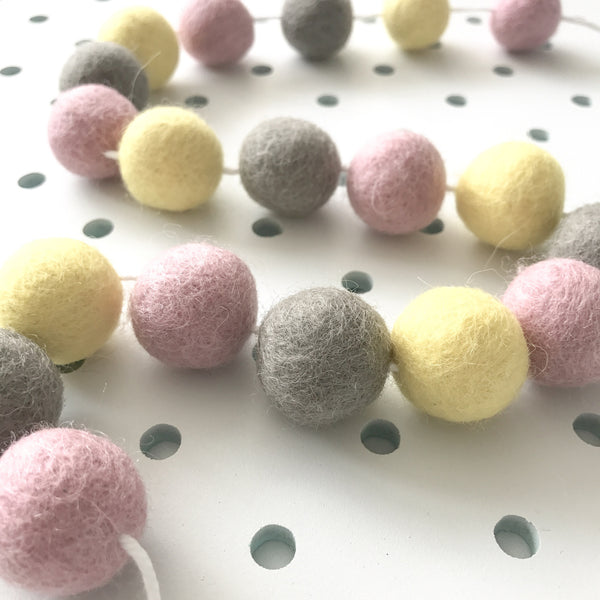 Stone and Co Felt Ball Pom Garland in Pastel Yellow, Dove and Dusty Pink