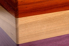 Solid padauk, cherry, and purple heart cajon with matching external snare.