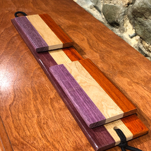 Padauk, cherry, and purpleheart external snare with matching click snares.