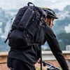 Biking with black ALPHA 31 backpack