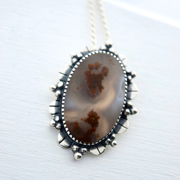 Paw Prints in the Snow Pendant with Moss Agate