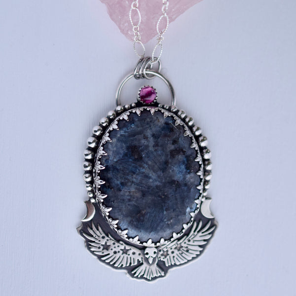 Celestial Raven Worry Stone Pendant with Larvikite and Garnet