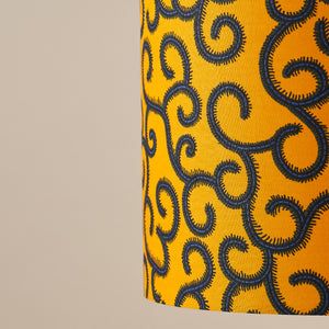 African wax print drum lampshade - yellow swirls