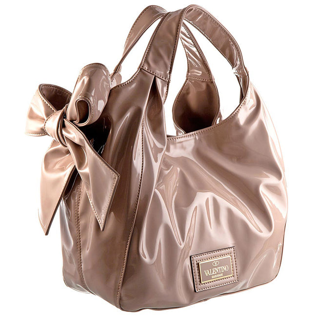 Product Shot Of A Patten Leather Beige Handbag