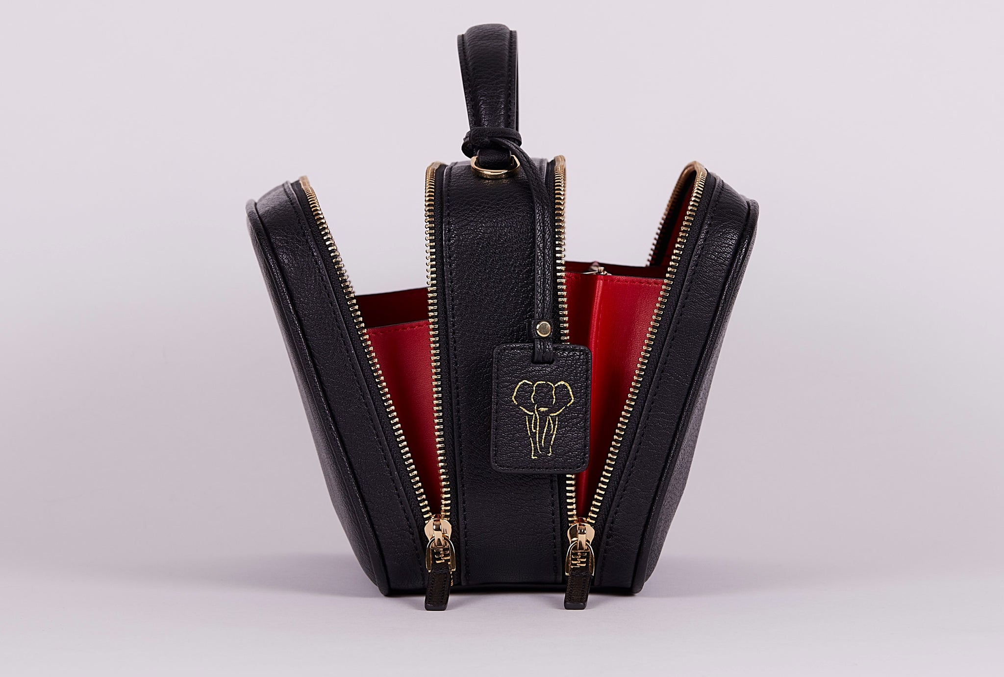 FERRON Vegan Signature Crossbody bag in black with an elephant logo tag