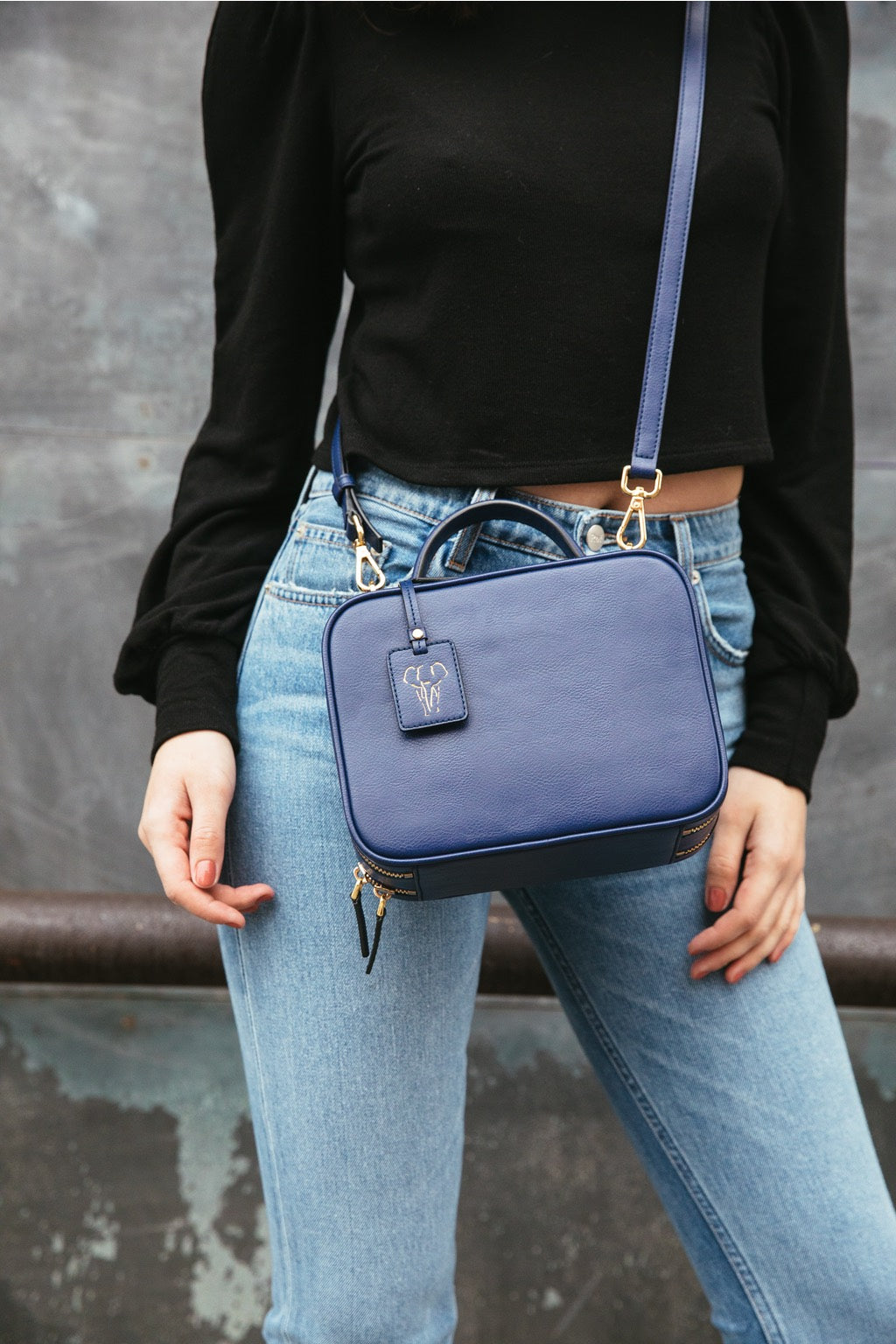 Model wearing FERRON crossbody vegan handbag
