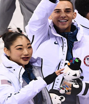 U.S. Figure Skater Mirai Nagasu Wearing FIRE Earrings by SONIA HOU Jewelry at Winter Olympics 2018 while posing with Adam Rippon