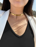 Female model wearing C.E.O. CHOKER STATEMENT NECKLACE IN 18K GOLD VERMEIL BY SONIA HOU JEWELRY
