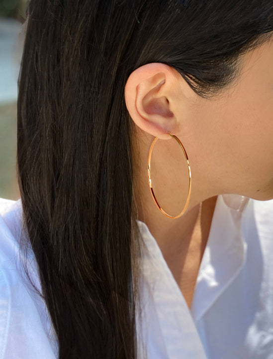 Female model wearing Eternity 18K Rose Gold Vermeil Hoop Earrings by Sonia Hou Jewelry