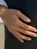 Female model wearing Thin Noodle Ring in 18K Gold Vermeil by Sonia Hou Jewelry