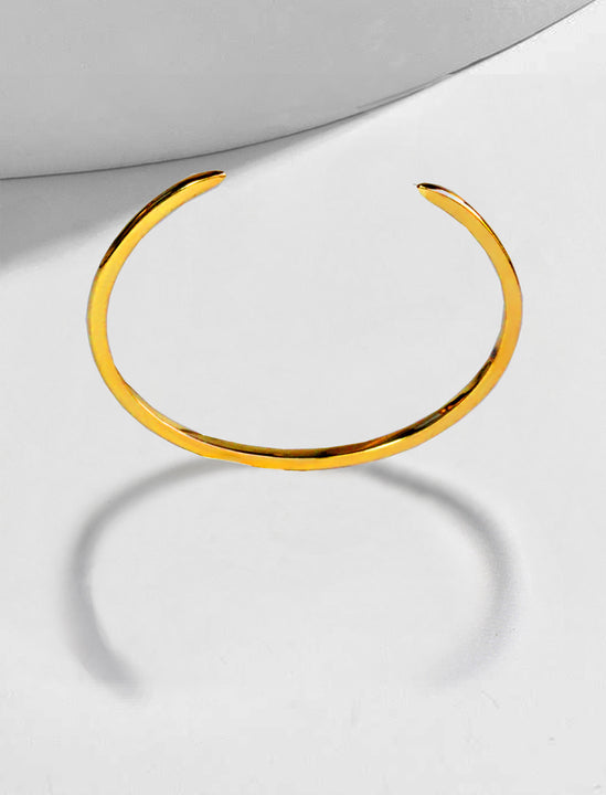 Female model wearing Success 18K Gold Vermeil Thin Cuff Bangle Bracelet by Sonia Hou Jewelry