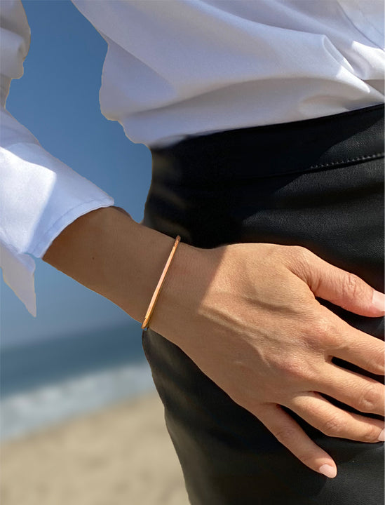 Female model wearing Success 18K Rose Gold Vermeil Thin Cuff Bangle Bracelet by Sonia Hou Jewelry