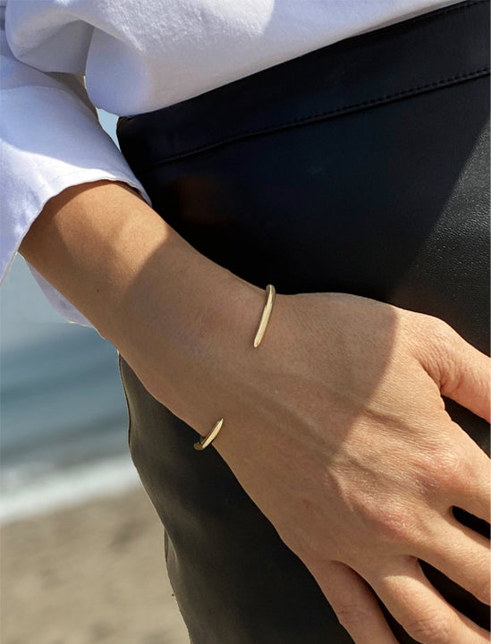 Female model wearing Success Sterling Silver Thin Cuff Bangle Bracelet by Sonia Hou Jewelry