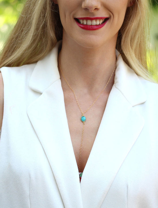 Girl Model Wearing A Lariat Gold Y Necklace In Blue Magnesite Gemstone by SONIA HOU Jewelry