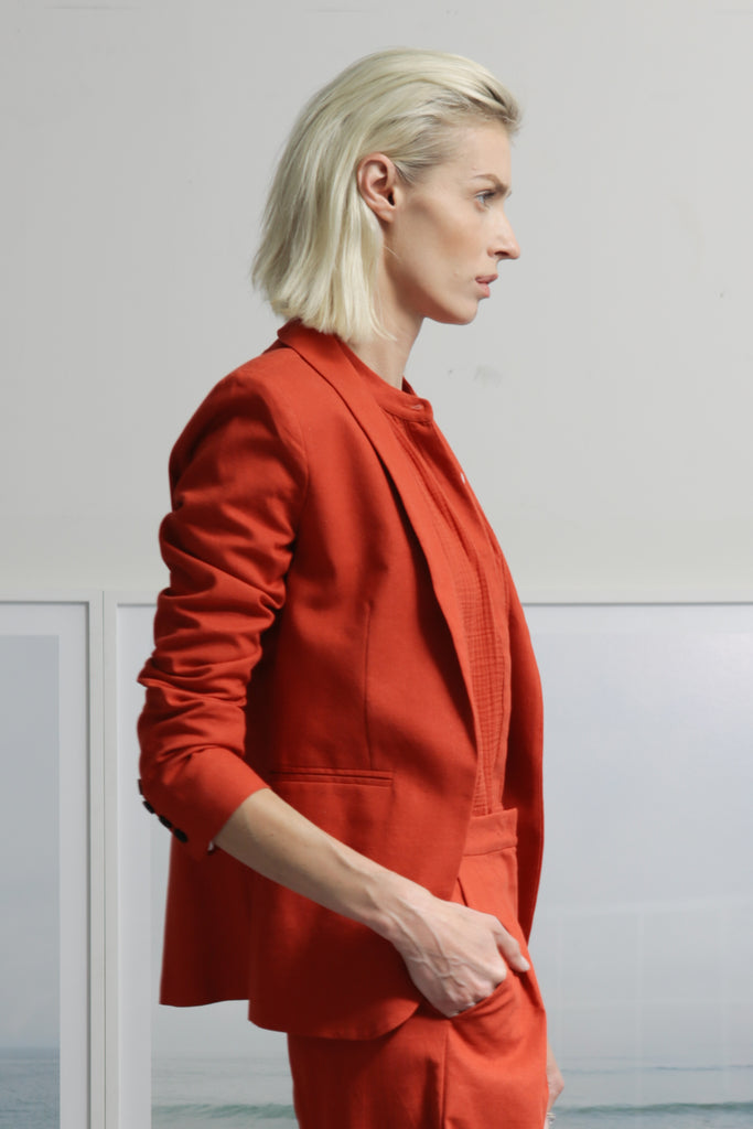 Model wears size 6 ILE BLAZER - color RED by Heidi Merrick made in Downtown Los Angeles