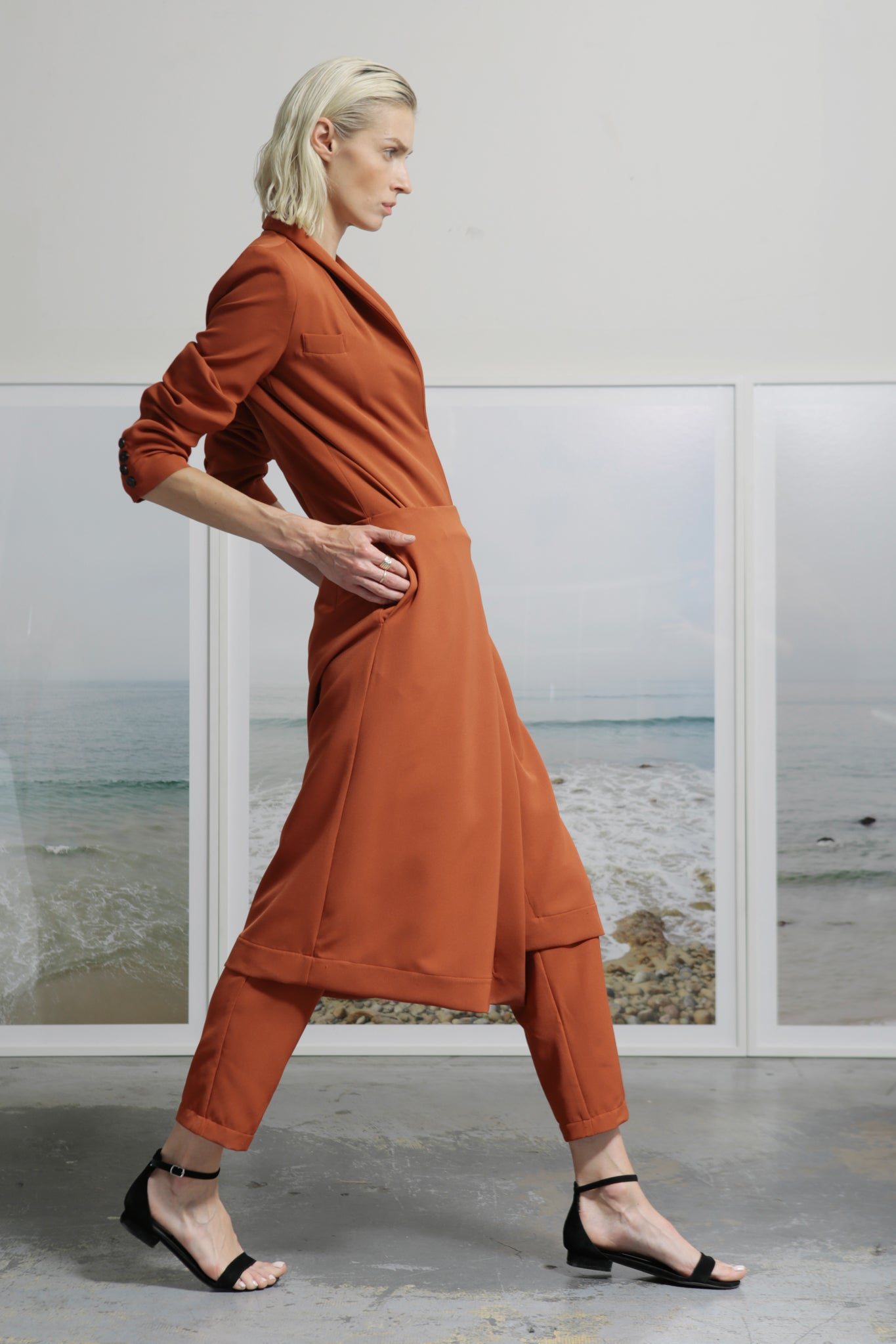 Model wears size Small FRIDA PANT SKIRT - RUST by Heidi Merrick made in Downtown Los Angeles