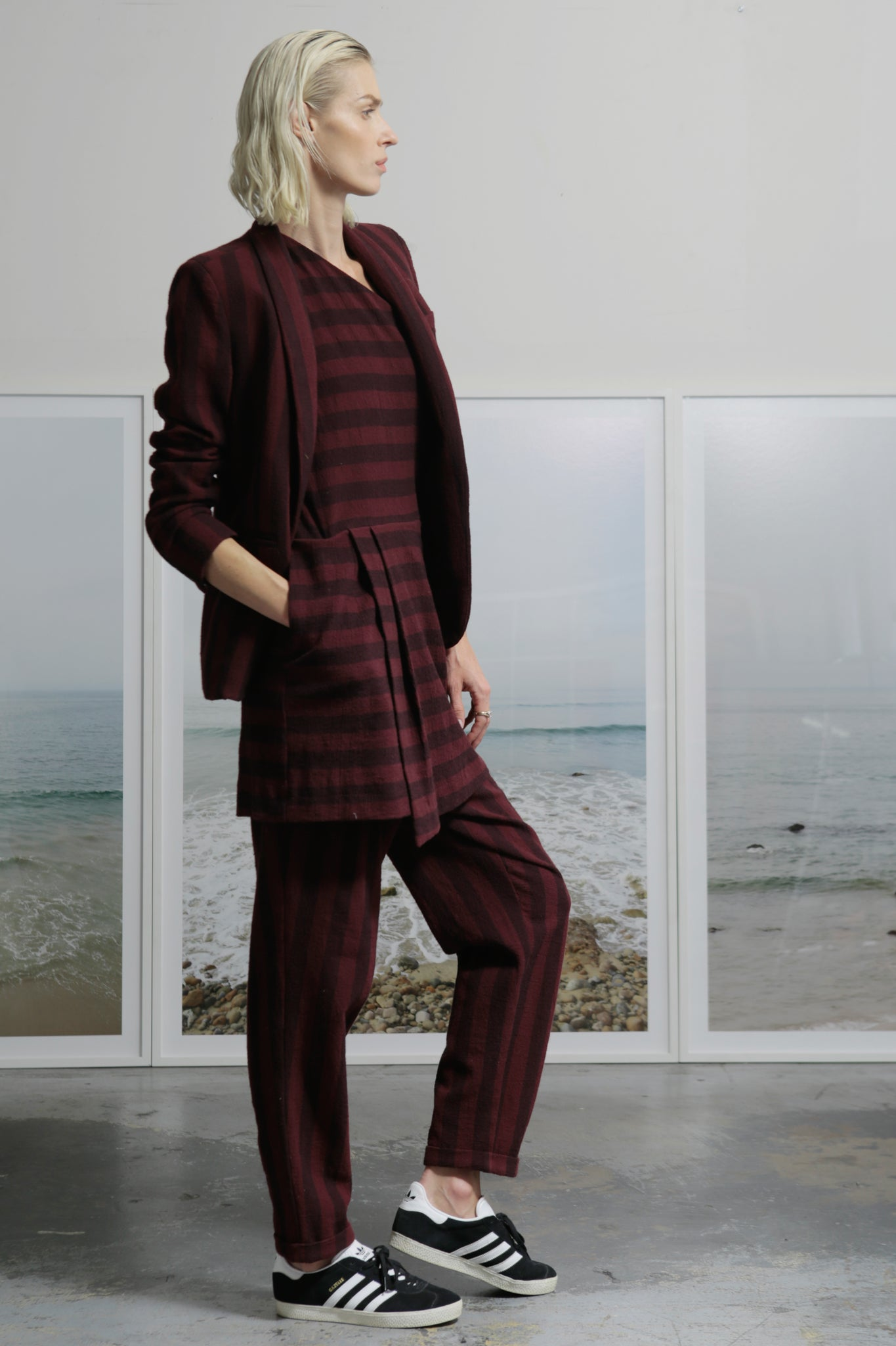 Model wears size 2 BETTE TROUSER - BURGUNDY STRIPE by Heidi Merrick (Side)