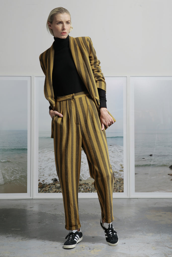 Model wears BETTE TROUSER - GOLD STRIPE by Heidi Merrick (Front)