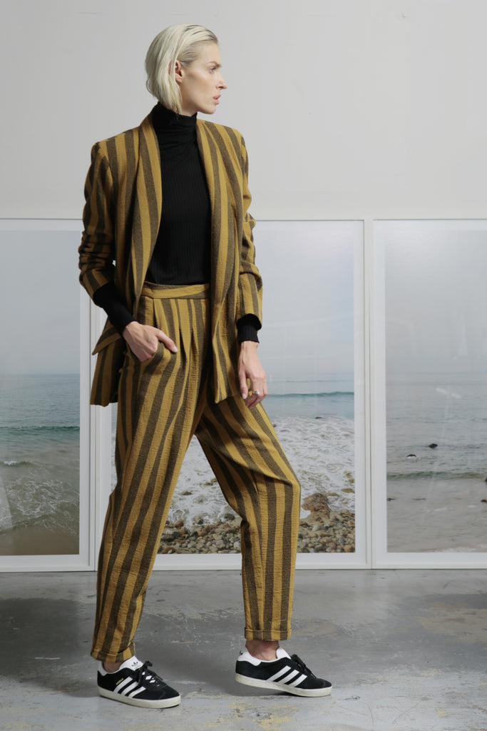 Model wears BETTE TROUSER - GOLD STRIPE by Heidi Merrick (Side)