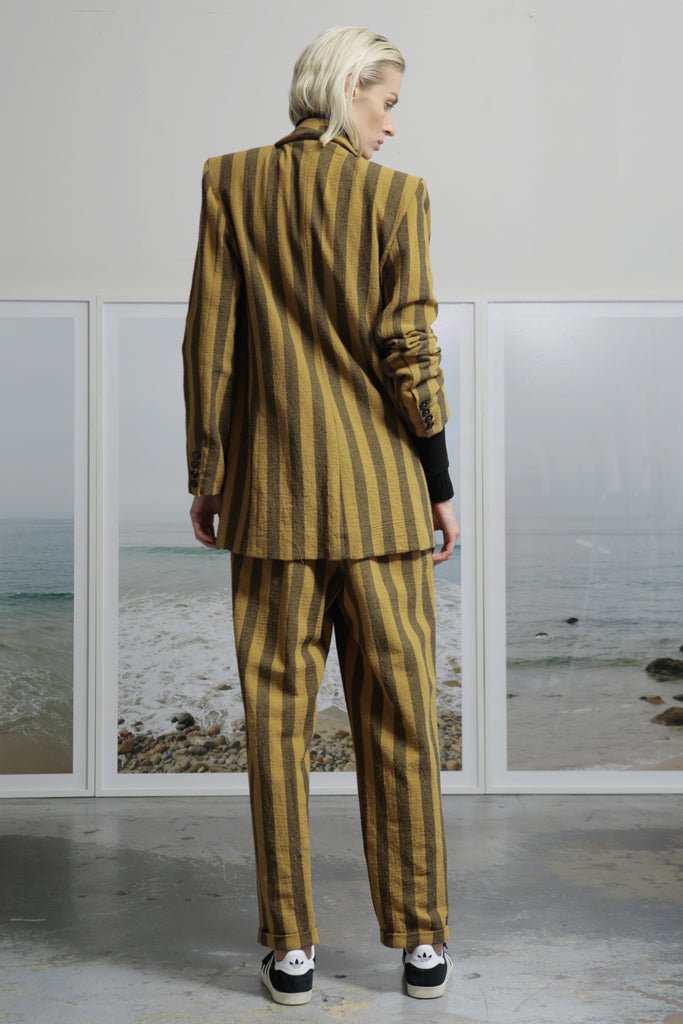Model wears BETTE TROUSER - GOLD STRIPE by Heidi Merrick (Back)