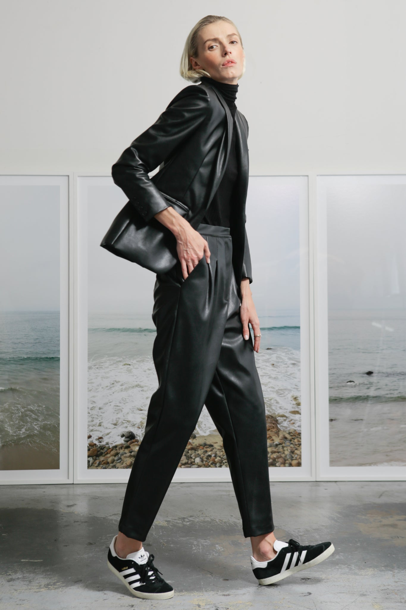 Model wears BETTE TROUSER - VEGAN LEATHER by Heidi Merrick (Side)