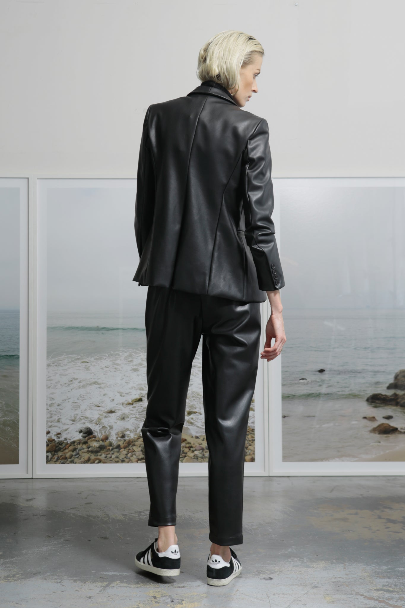 Model wears BETTE TROUSER - VEGAN LEATHER by Heidi Merrick (Back)