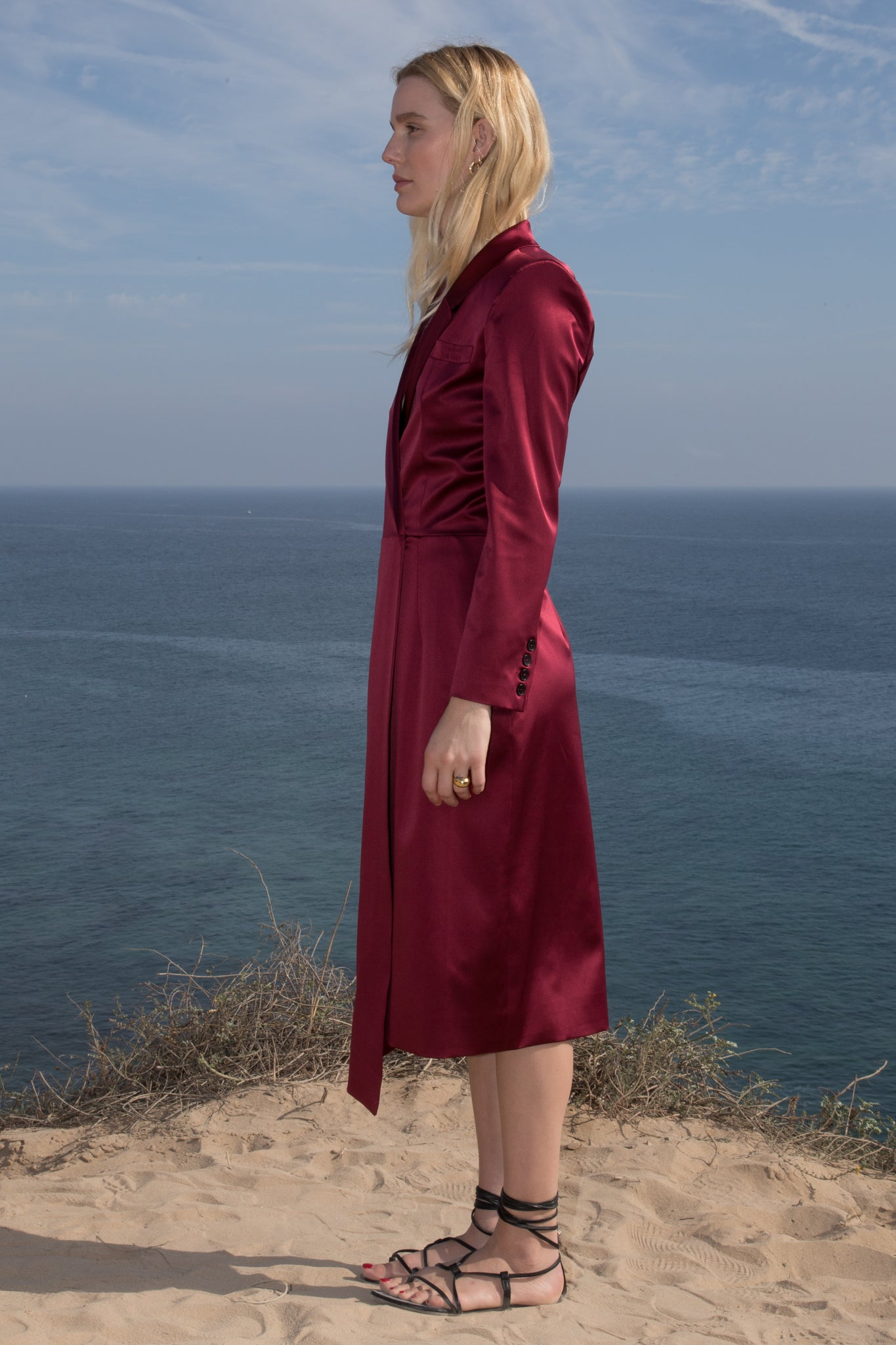Model wears BLAZER DRESS - CRIMSON by Heidi Merrick (Side)