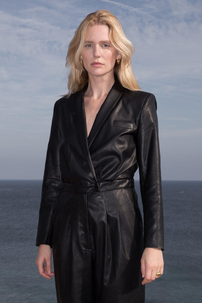 Model wears BLAZER JUMPSUIT - VEGAN LEATHER by Heidi Merrick (Close up)