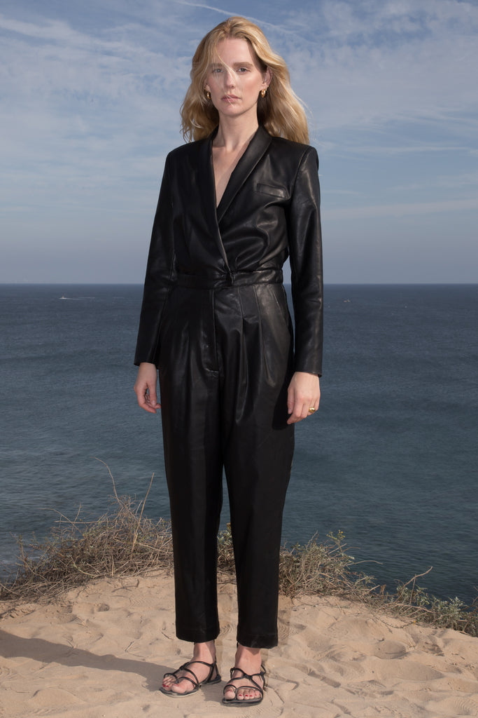 Model wears BLAZER JUMPSUIT - VEGAN LEATHER by Heidi Merrick (Front)