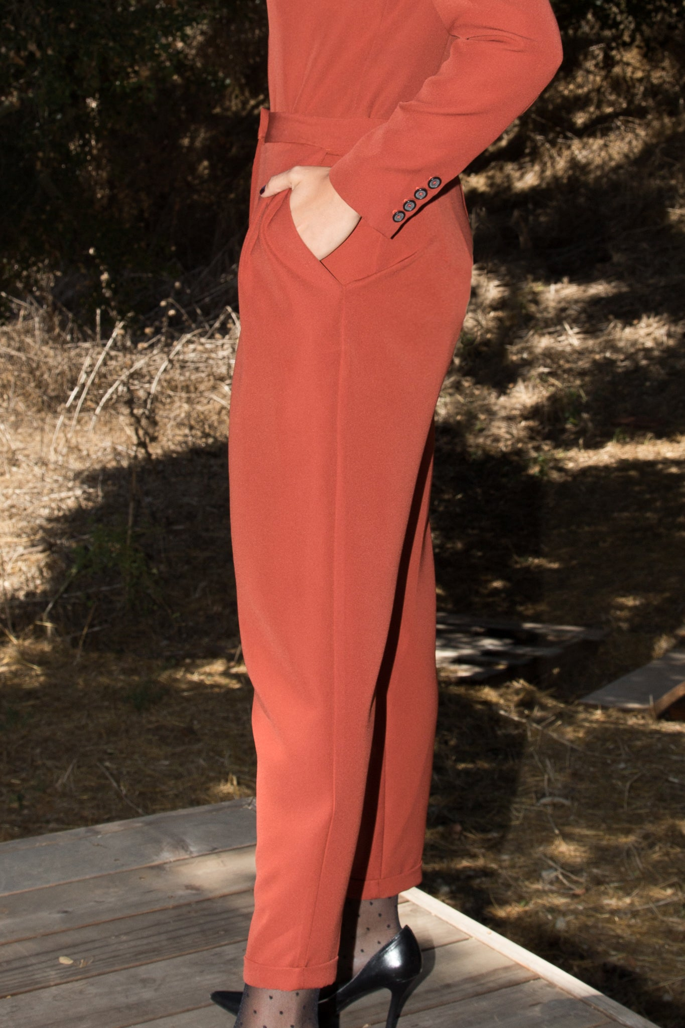 Model wears BETTE TROUSER - RUST by Heidi Merrick Made in Downtown Los Angeles (Side)