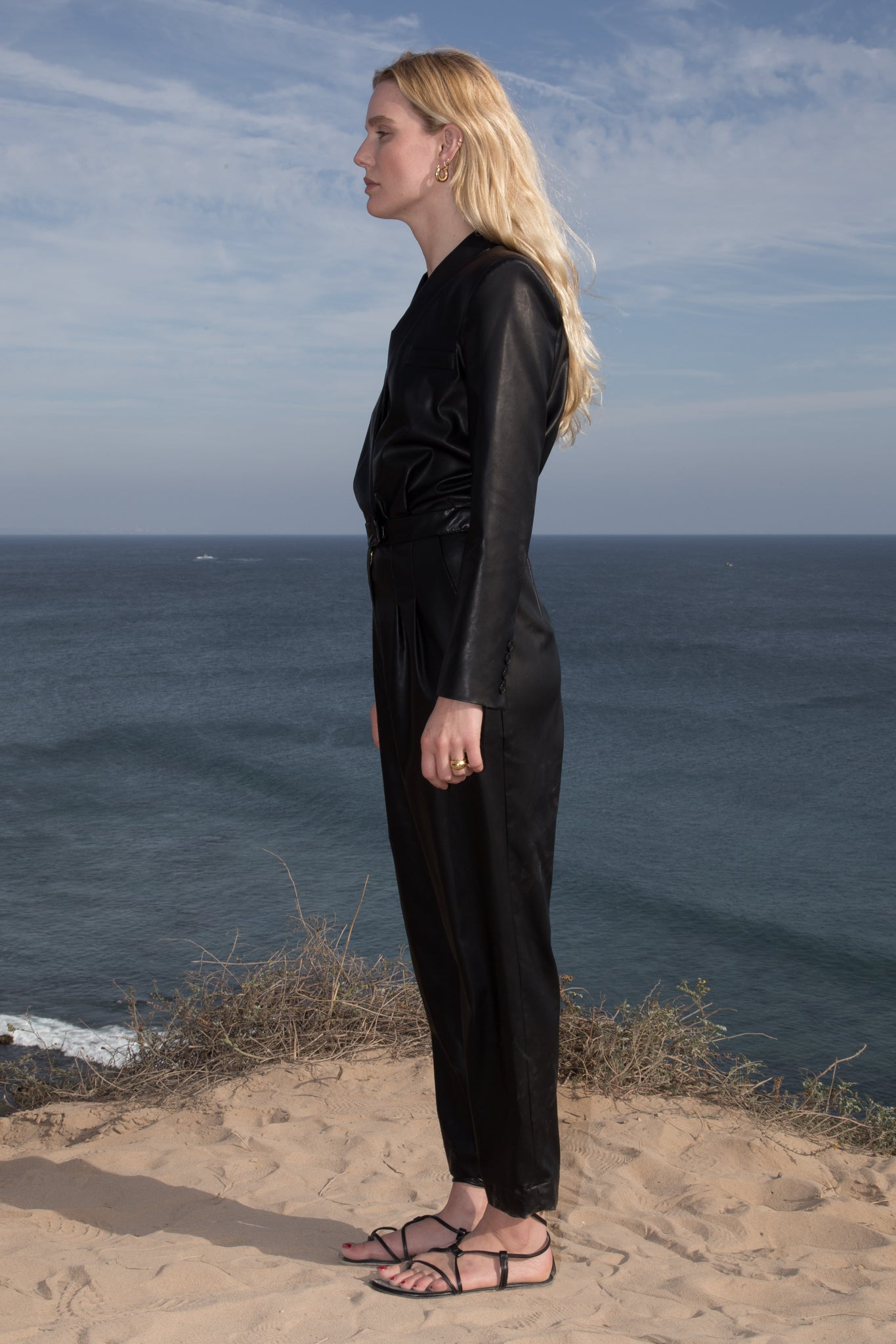 Model wears BLAZER JUMPSUIT - VEGAN LEATHER by Heidi Merrick (Side)