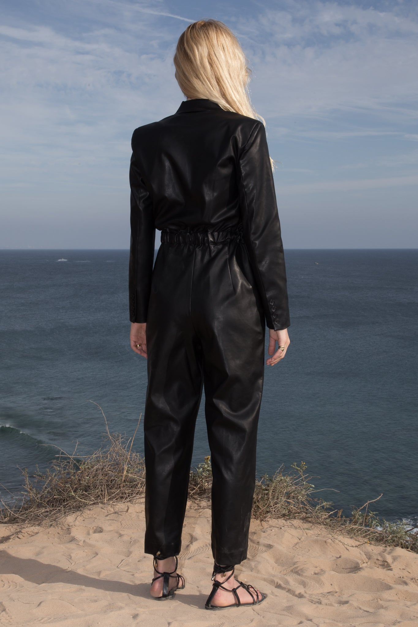 Model wears BLAZER JUMPSUIT - VEGAN LEATHER by Heidi Merrick (Back)