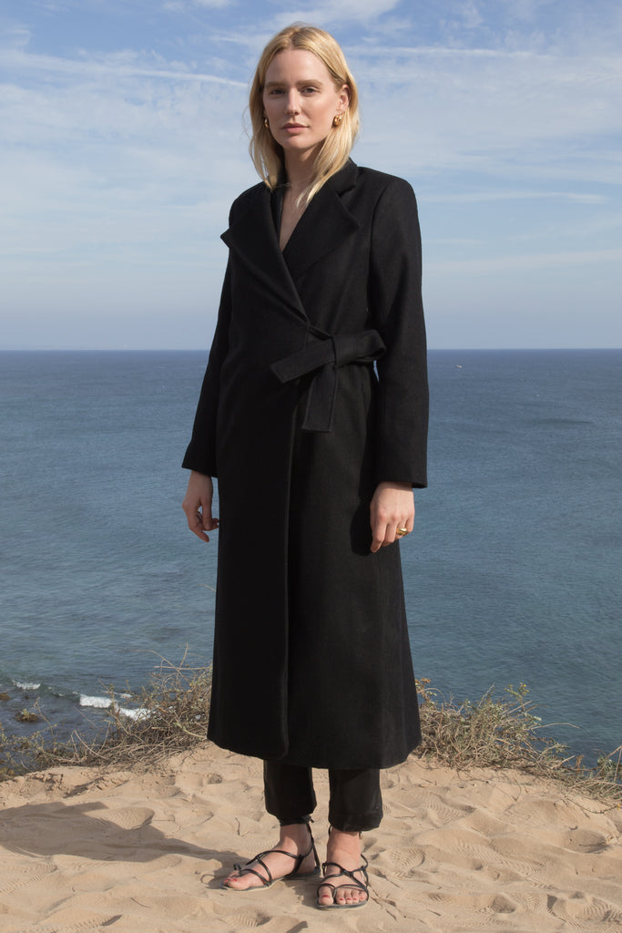 Model wears BELTED VULCAN COAT - BLACK - WHITE by Heidi Merrick (Front)