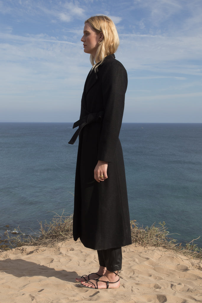 Model wears BELTED VULCAN COAT - BLACK - WHITE by Heidi Merrick (Side)