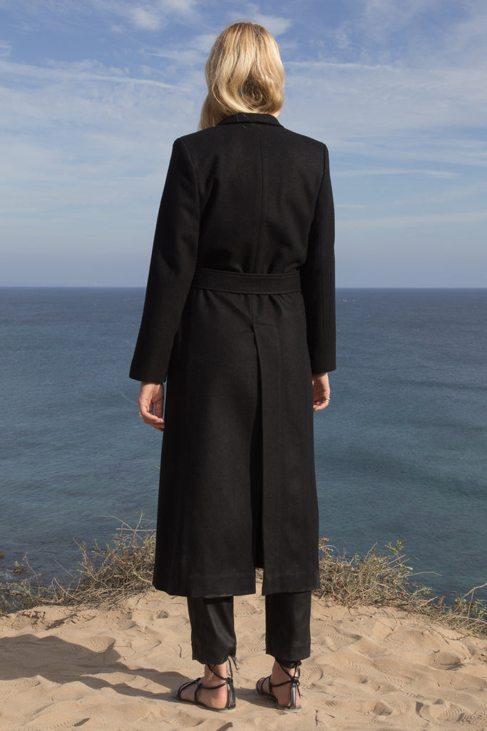 Model wears BELTED VULCAN COAT - BLACK - WHITE by Heidi Merrick (Back)