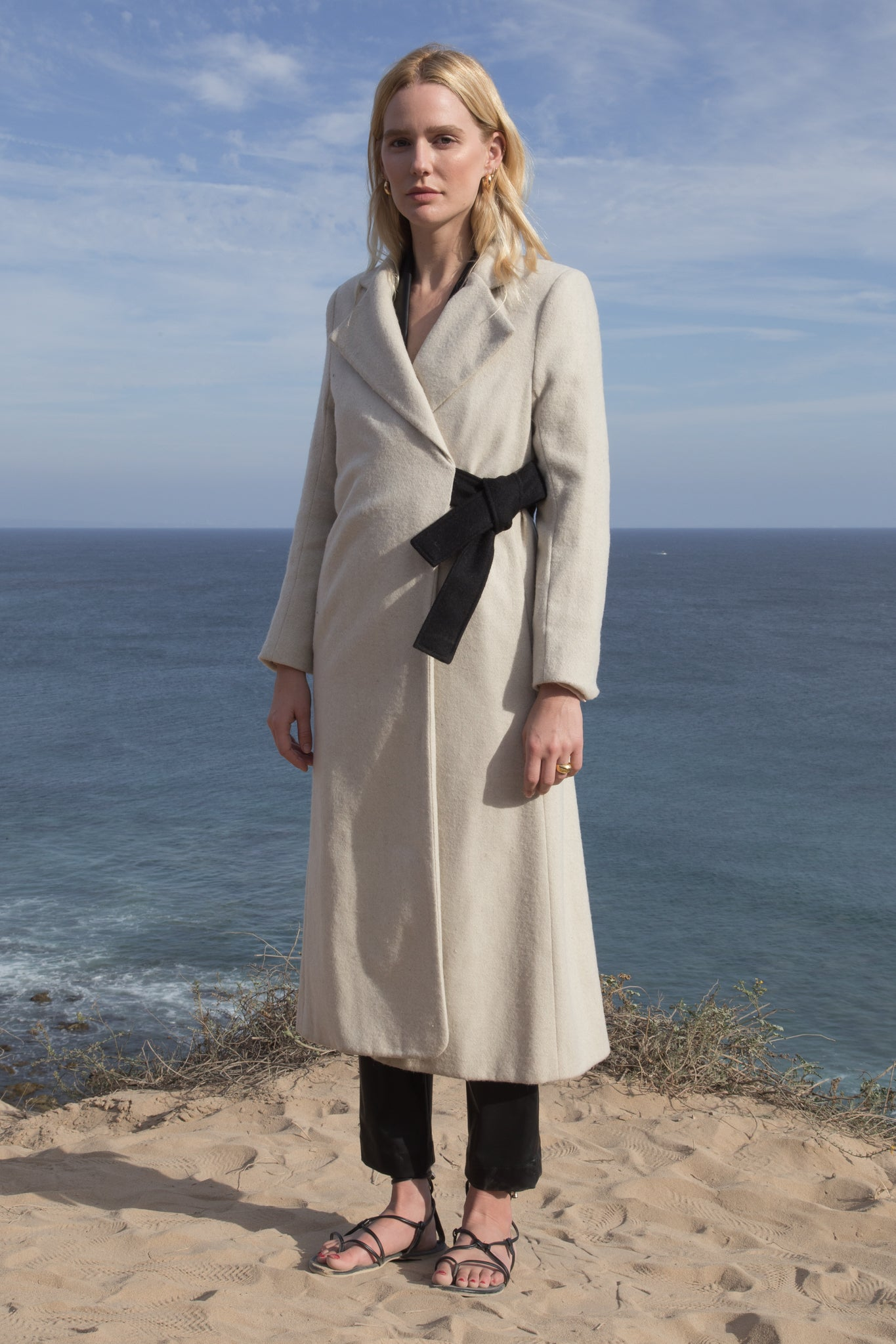 Model wears BELTED VULCAN COAT - IVORY by Heidi Merrick (Front)