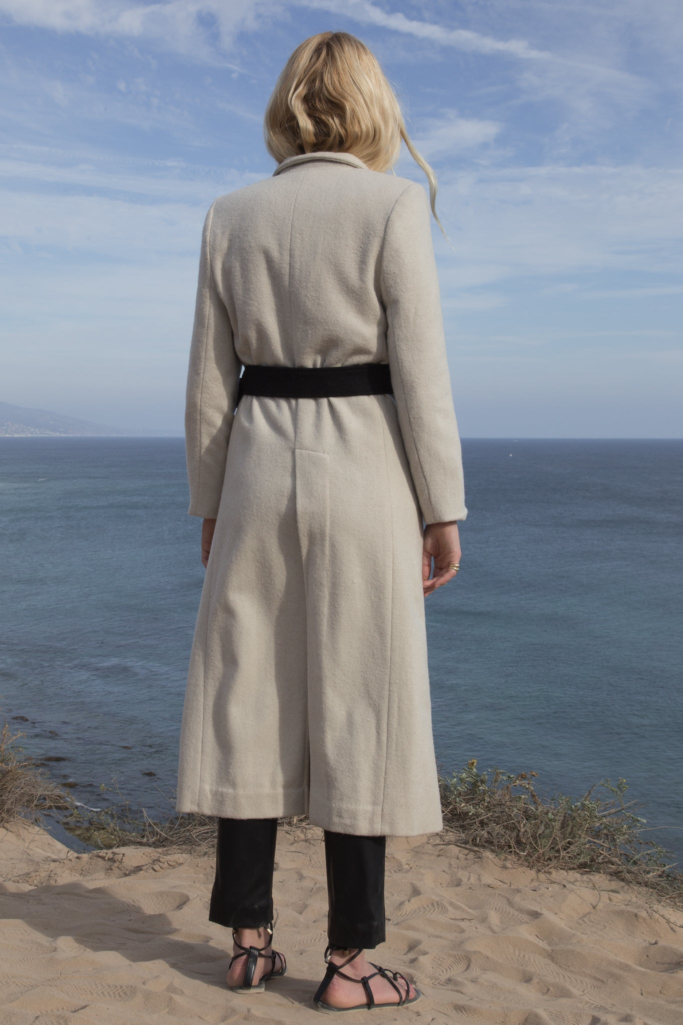 Model wears BELTED VULCAN COAT - IVORY by Heidi Merrick (Back)