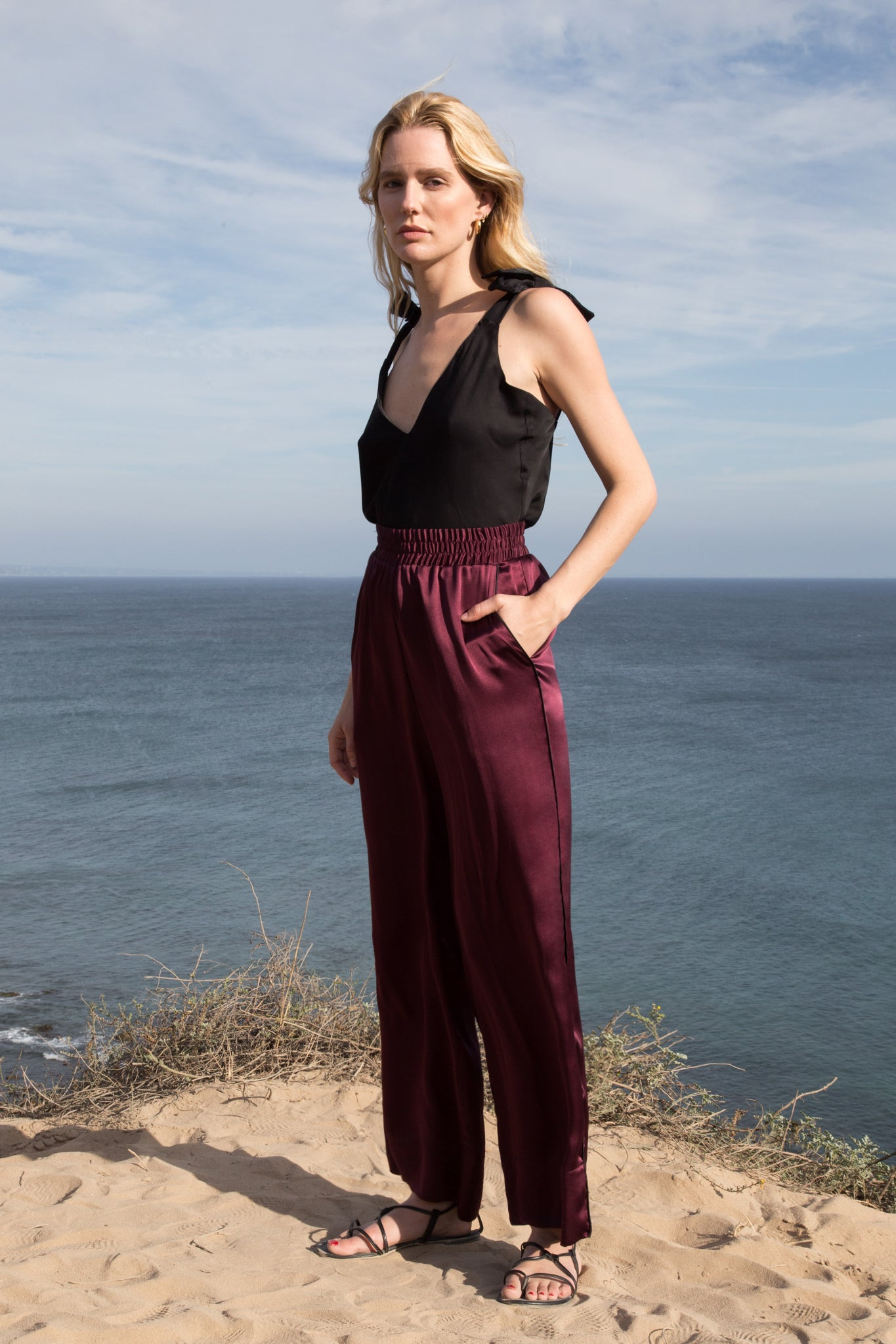 Model wears SAHARA PANT - BURGUNDY by Heidi Merrick (Front)
