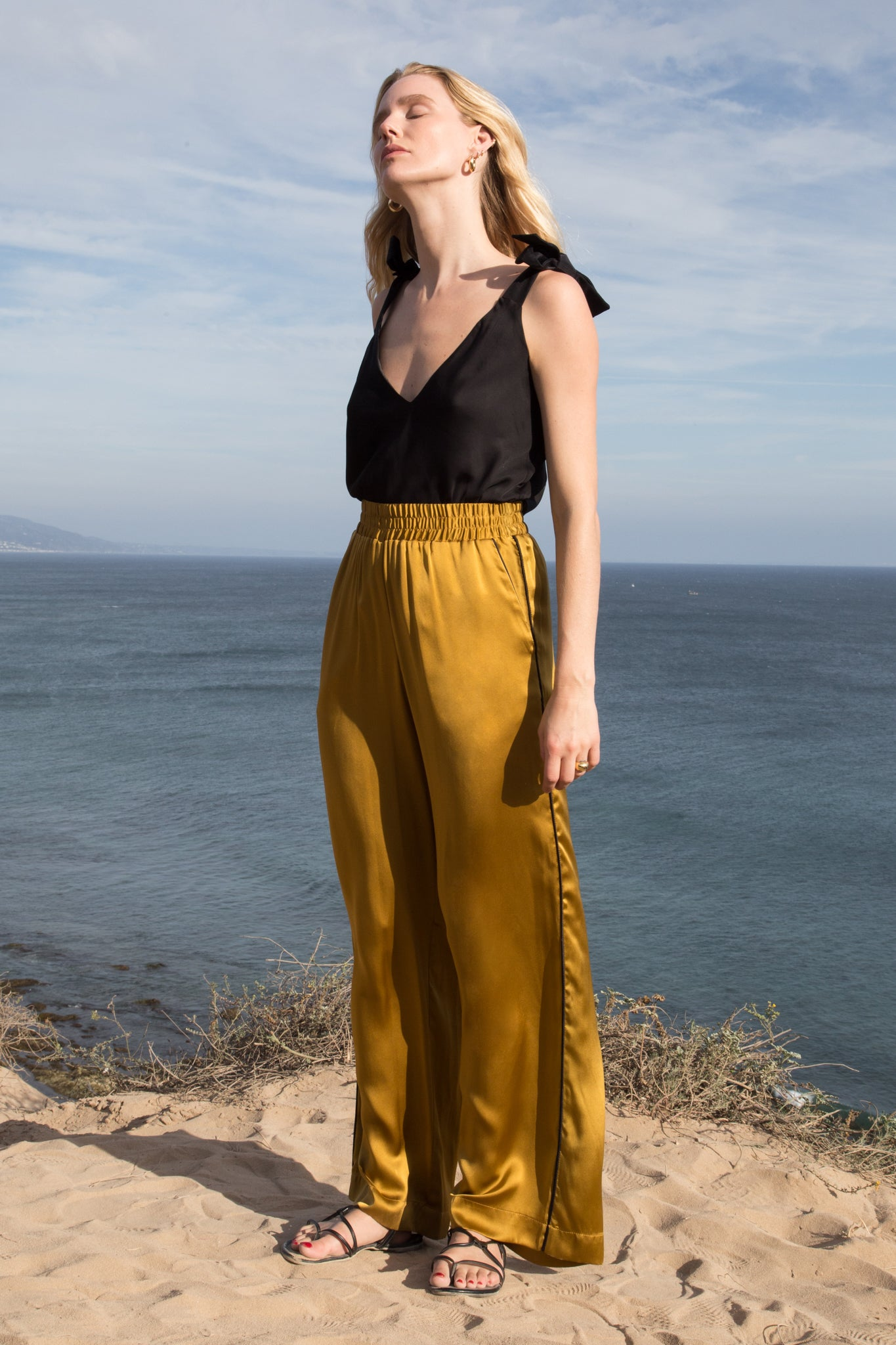 Model wears SAHARA PANT - GOLD by Heidi Merrick (Front)