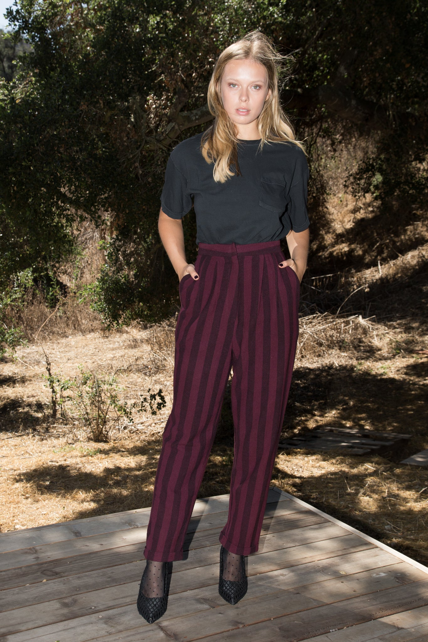 Model wears size 2 BETTE TROUSER - BURGUNDY STRIPE by Heidi Merrick (Front)