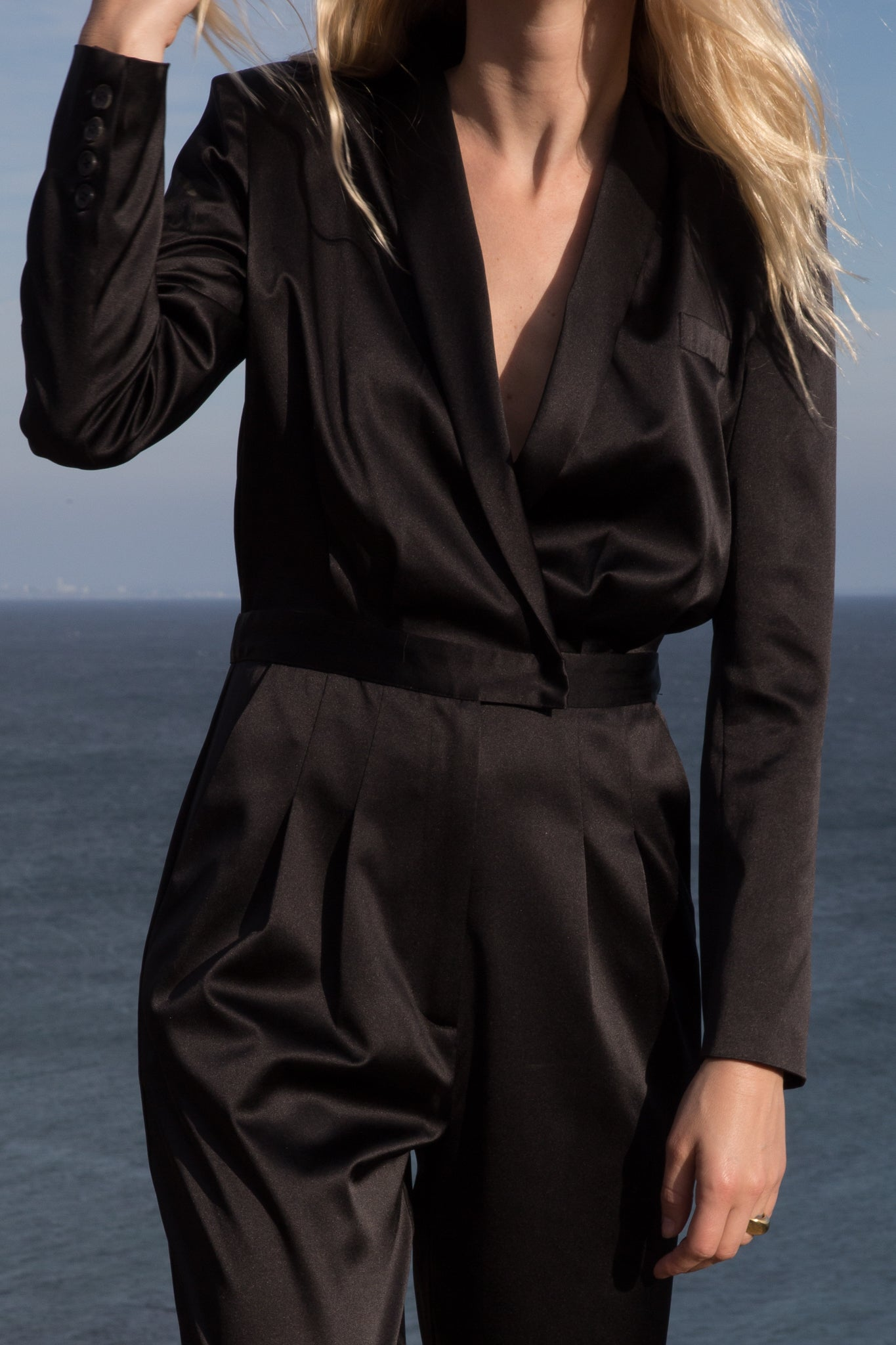 Model wears BLAZER JUMPSUIT - BLACK by Heidi Merrick (Close up)