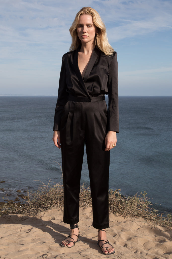 Model wears BLAZER JUMPSUIT - BLACK by Heidi Merrick (Front)
