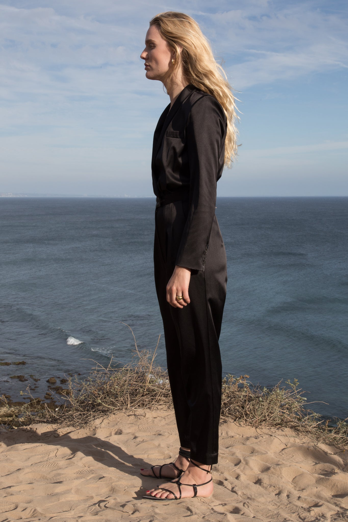 Model wears BLAZER JUMPSUIT - BLACK by Heidi Merrick (Side)