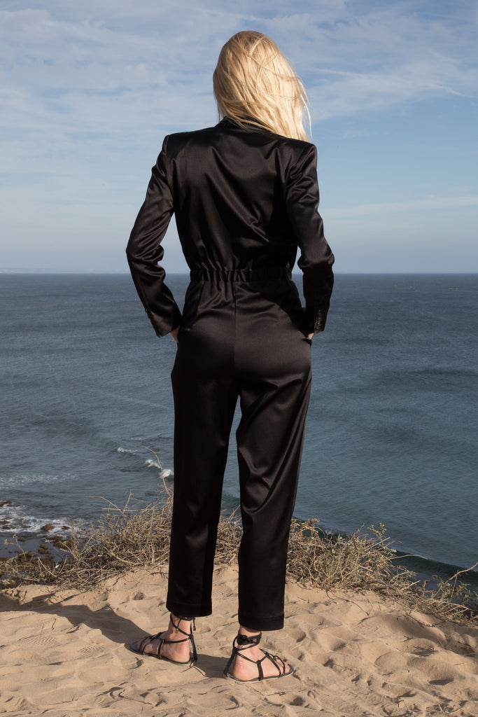 Model wears BLAZER JUMPSUIT - BLACK by Heidi Merrick (Back)