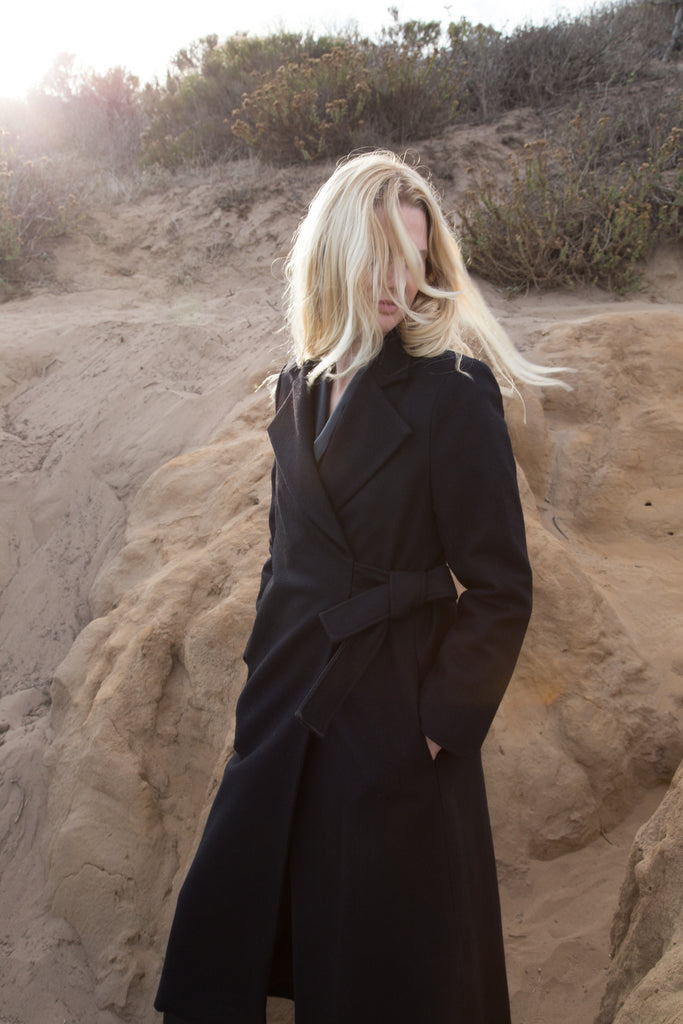 Model wears BELTED VULCAN COAT - BLACK - WHITE by Heidi Merrick (Overview)