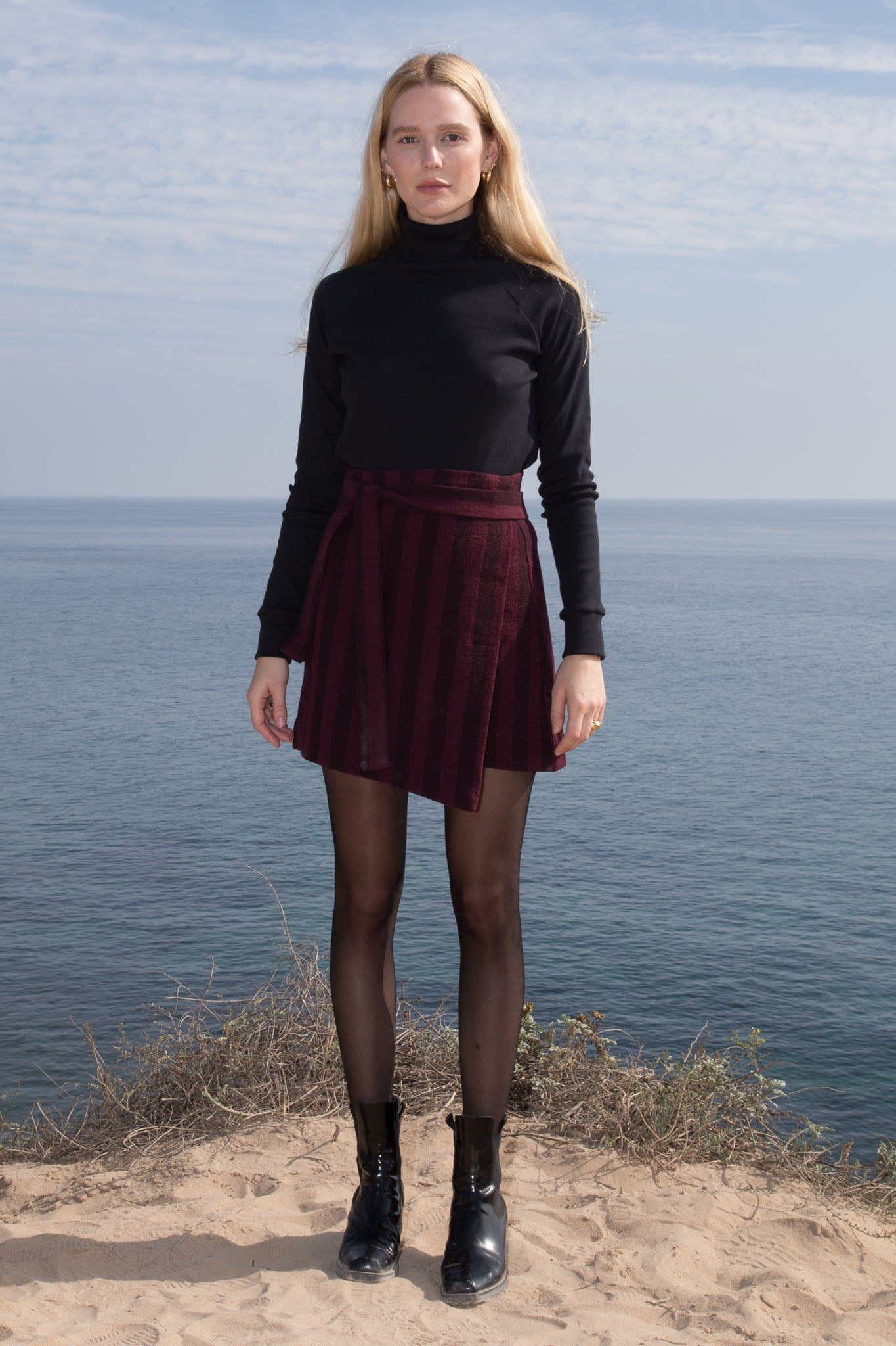 Model wears Small VIGNETO SKIRT - BURGUNDY STRIPE by Heidi Merrick (Front)