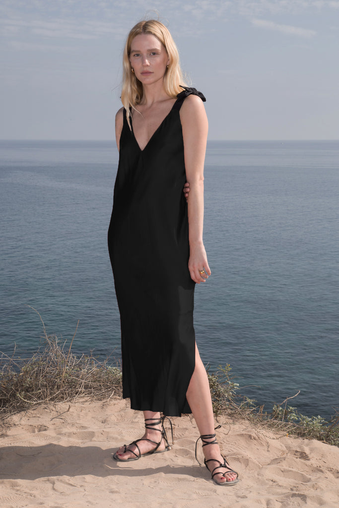 Model wears MARION SLIP DRESS - Black by Heidi Merrick (Front)